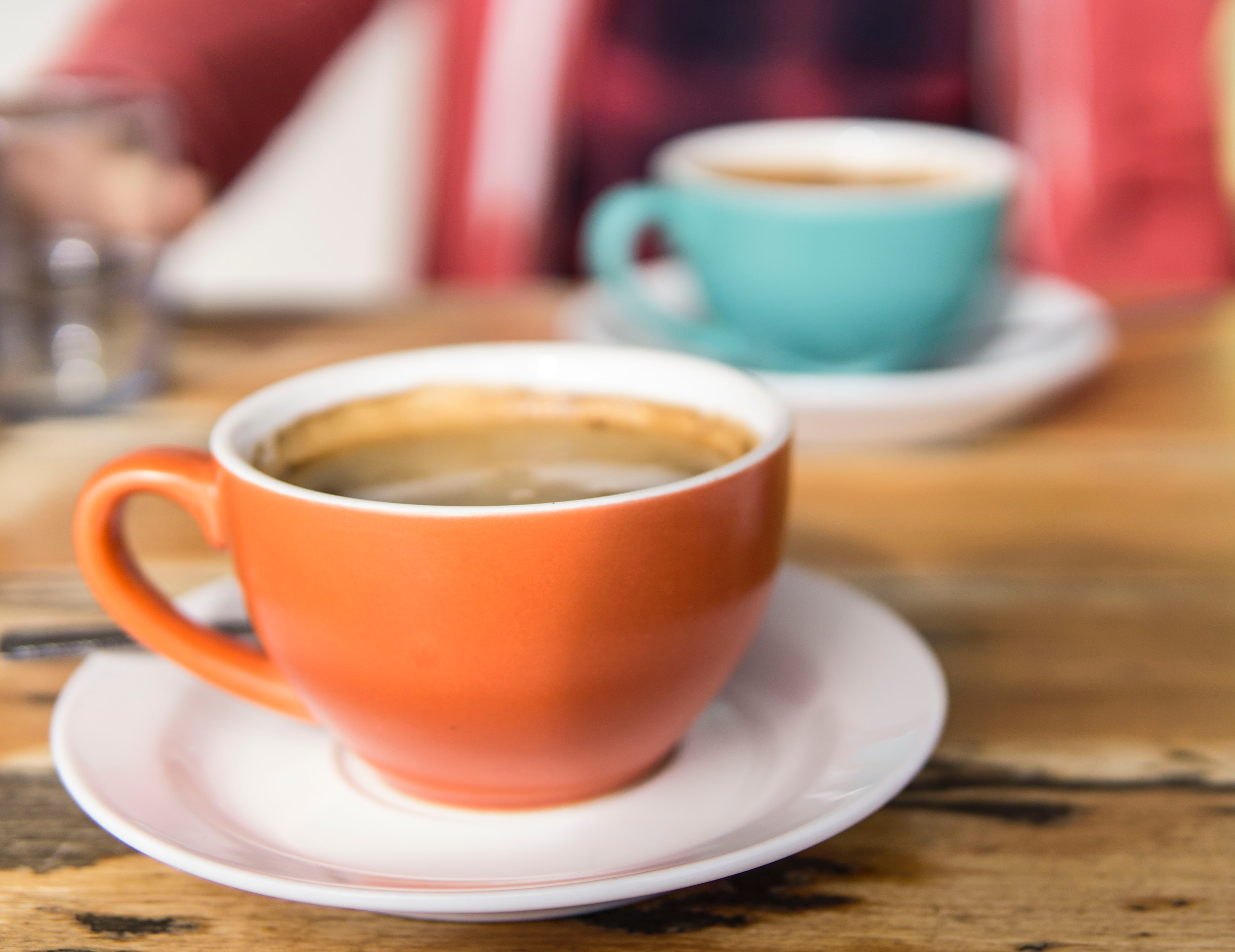 Orange and Teal Coffee Cups